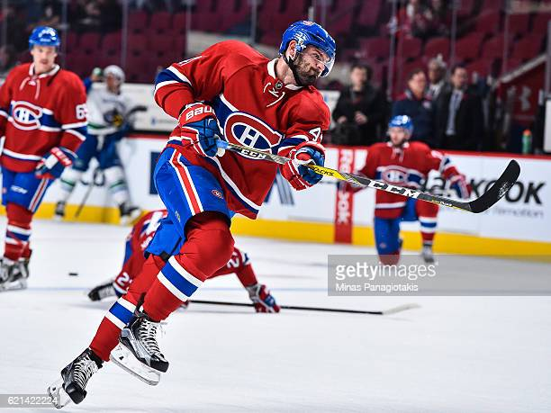 Alexander Radulov of the Montreal Canadiens takes a shot during the warmup prior to the NHL game against the Vancouver Canucks at the Bell Centre on...