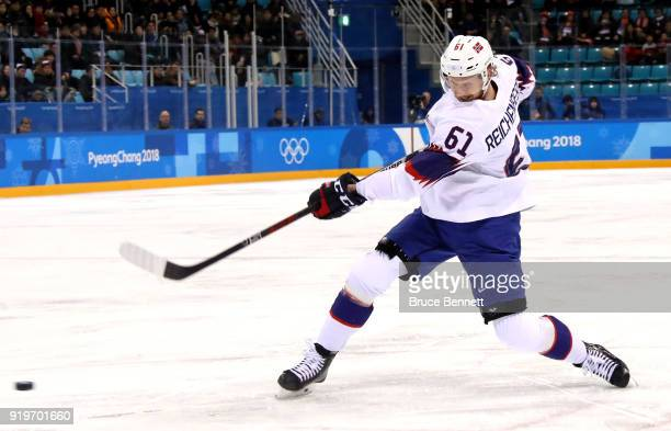 Alexander Reichenberg of Norway shoots and scores in the third period against Germany during the Men's Ice Hockey Preliminary Round Group B game on...