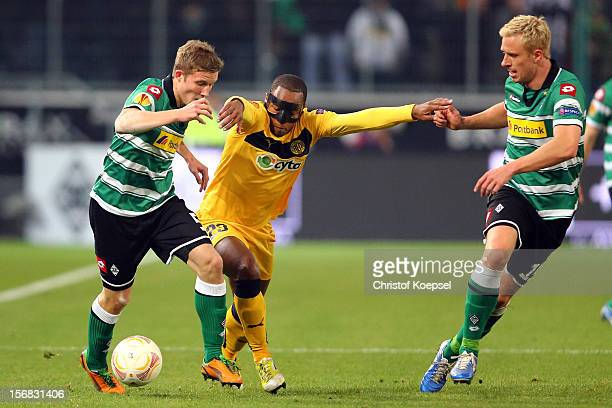 Alexander Ring of Moenchengladbach and Mike Hanke of Moenchengladbach challenge Carlitos of Limassol during the UEFA Europa League group C match...