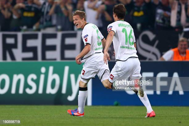 Alexander Ring of Moenchengladcbach celebrates the first goal with Havard Nordtveit during the UEFA Champions League playoff first leg match between...