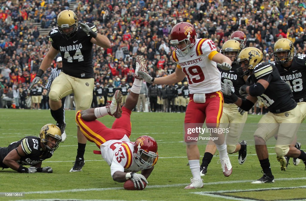 Alexander Robinson #33 of the Iowa State Cyclones dives into the endzone with an eight yard touchdown run in the second quarter against the Colorado Buffaloes at Folsom Field on November 13, 2010 in Boulder, Colorado. Colorado defeated Iowa State 34-14.