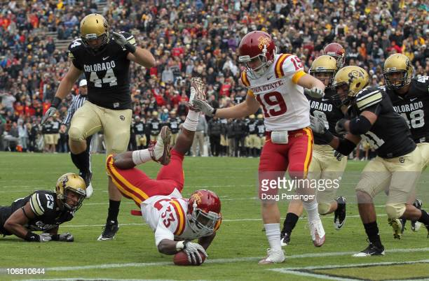 Alexander Robinson of the Iowa State Cyclones dives into the endzone with an eight yard touchdown run in the second quarter against the Colorado...