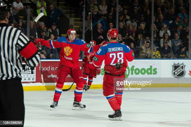 Alexander Romanov and Grigory Denisenko of Team Russia celebrates a goal with a teammate against the Team Sweden during the first period at Prospera...