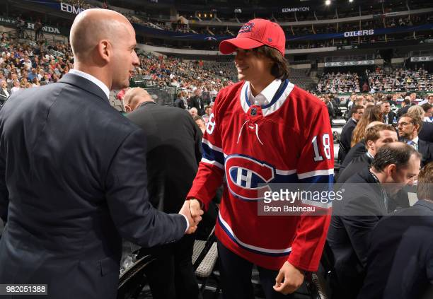Alexander Romanov meets a member of the Montreal Canadiens draft personnel after being selected 38th overall by the Montreal Canadiens during the...