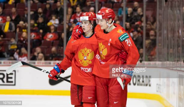 Alexander Romanov of Russia celebrates with teammate Klim Kostin after scoring a goal against Denmark in Group A hockey action of the 2019 IIHF World...