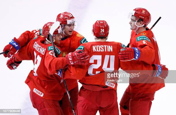 Alexander Romanov of Russia celebrates with teammates Grigori Denisenko Klim Kostin and Ilya Morozov after a second period goal during a bronze medal...