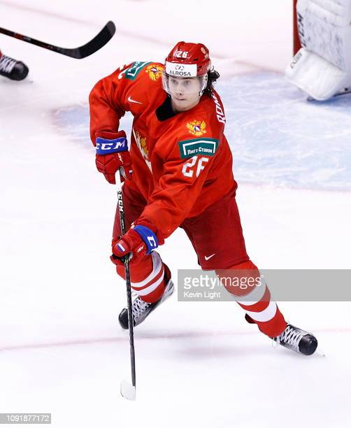 Alexander Romanov of Russia passes the puck against Switzerland during a bronze medal game at the IIHF World Junior Championships at Rogers Arena on...