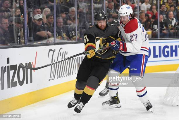 Alexander Romanov of the Montreal Canadiens battles Jonathan Marchessault of the Vegas Golden Knights during the first period in Game One of the...