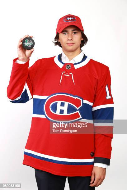 Alexander Romanov poses after being selected 38th overall by the Montreal Canadiens during the 2018 NHL Draft at American Airlines Center on June 23...
