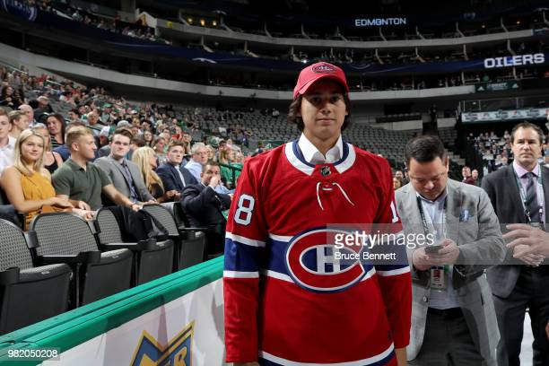 Alexander Romanov reacts after being selected 38th overall by the Montreal Canadiens during the 2018 NHL Draft at American Airlines Center on June 23...
