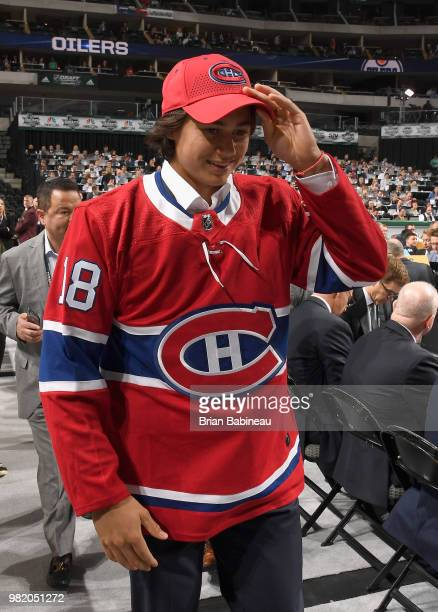 Alexander Romanov walks the draft floor after being selected 38th overall by the Montreal Canadiens during the 2018 NHL Draft at American Airlines...