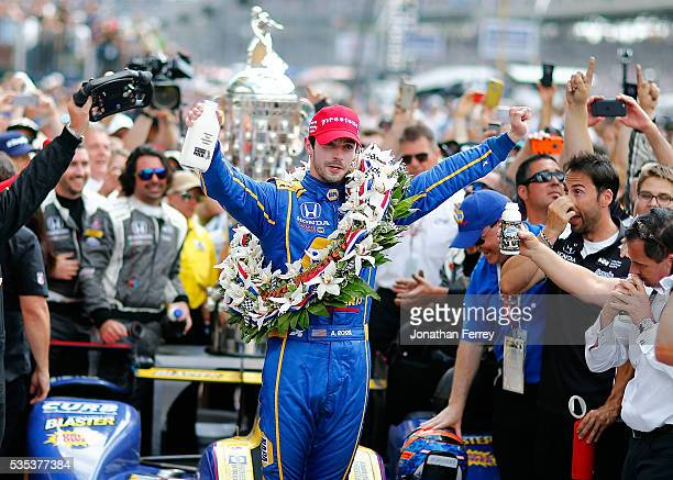Alexander Rossi driver of the Andretti Herta Autosport Napa Dallara Honda celebrates in victory circle after winning the 100th Running of the...