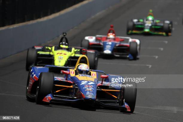Alexander Rossi driver of the NAPA Auto Parts Honda leads a pack of cars during the 102nd Running of the Indianapolis 500 at Indianapolis...