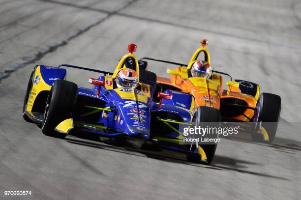 Alexander Rossi driver of the NAPA Auto Parts Honda leads Zach Veach driver of the Relay Group 1001 Honda during the Verizon IndyCar Series DXC...