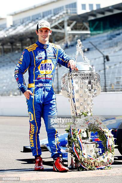 Alexander Rossi of the United States driver of the Andretti Herta Autosport Honda Dallara poses with the BorgWarner trophy during a photoshoot after...
