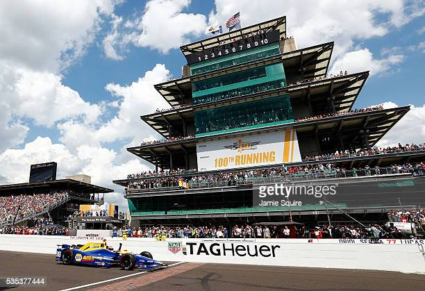 Alexander Rossi of the United States pumps his fist as he crosses the finish line to win the 100th running of the Indianapolis 500 at Indianapolis...