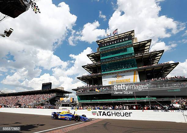 Alexander Rossi of the United States pumps his fist as he takes the checkered flag to win the 100th running of the Indianapolis 500 at Indianapolis...