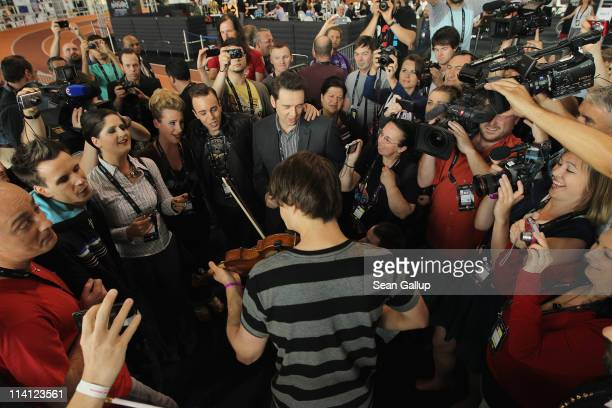 Alexander Rybak winner of the 2009 Eurovision Song Contest plays his violin with Belgian contestants Witloof Bay in an impromptu jam as other people...