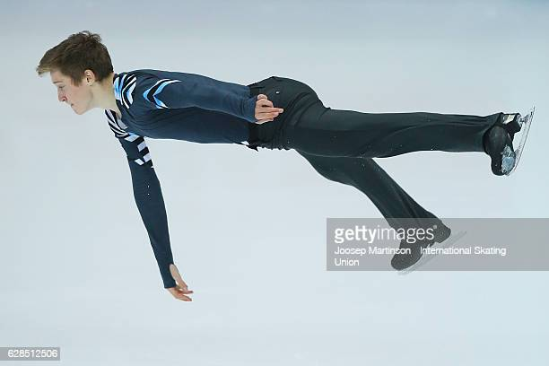 Alexander Samarin of Russia competes during Junior Men's Short Program on day one of the ISU Junior and Senior Grand Prix of Figure Skating Final at...