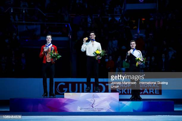 Alexander Samarin of Russia Javier Fernandez of Spain and Matteo Rizzo of Italy pose in the Men's medal ceremony during day four of the ISU European...