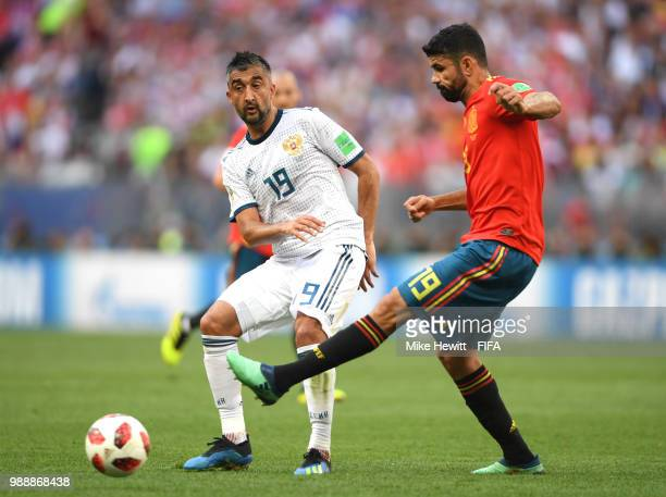 Alexander Samedov of Russia and Diego Costa of Spain battle for the ball during the 2018 FIFA World Cup Russia Round of 16 match between Spain and...