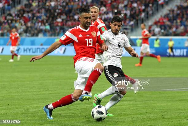 Alexander Samedov of Russia battles for possession with Tarek Hamed of Egypt during the 2018 FIFA World Cup Russia group A match between Russia and...