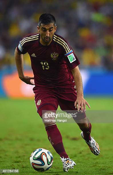 Alexander Samedov of Russia controls the ball during the 2014 FIFA World Cup Brazil Group H match between Algeria and Russia at Arena da Baixada on...