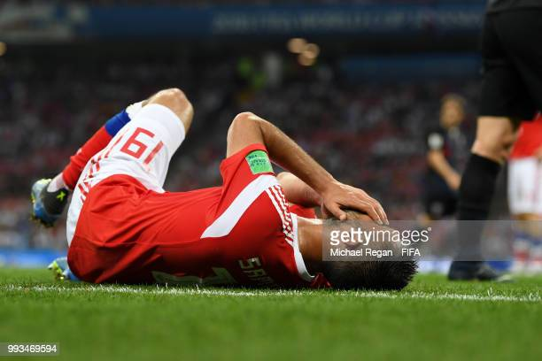 Alexander Samedov of Russia goes down injured during the 2018 FIFA World Cup Russia Quarter Final match between Russia and Croatia at Fisht Stadium...