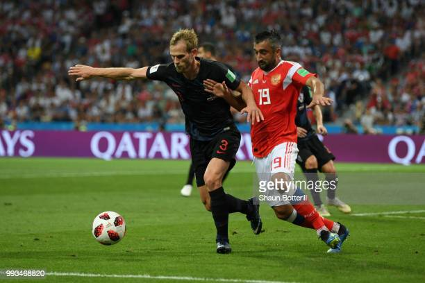 Alexander Samedov of Russia is challenged by Ivan Strinic of Croatia during the 2018 FIFA World Cup Russia Quarter Final match between Russia and...