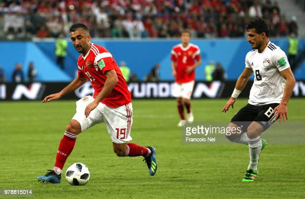 Alexander Samedov of Russia is challenged by Tarek Hamed of Egypt during the 2018 FIFA World Cup Russia group A match between Russia and Egypt at...