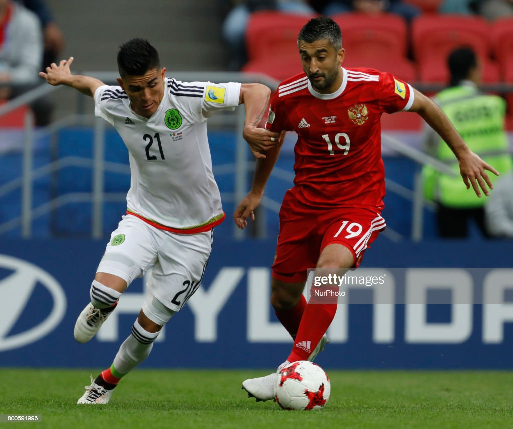 Alexander Samedov (R) of Russia national team and Luis Reyes of Mexico national team vie for the ball during the Group A - FIFA Confederations Cup Russia 2017 match between Russia and Mexico at Kazan Arena on June 24, 2017 in Kazan, Russia.