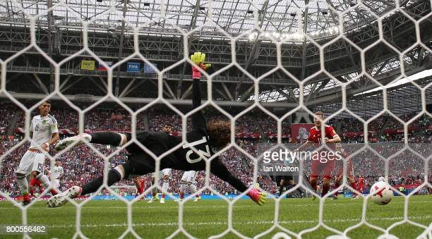 Alexander Samedov of Russia scores his sides first goal past Guillermo Ochoa of Mexico during the FIFA Confederations Cup Russia 2017 Group A match...