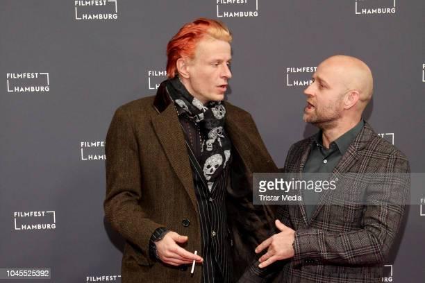 Alexander Scheer and Juergen Vogel attend the 'Blochin Das letzte Kapitel' premiere during the Film Festival on October 03 2018 in Hamburg Germany