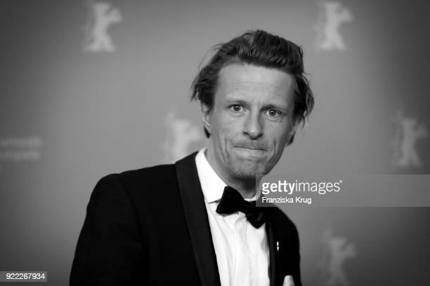 Image has been converted to black and white Alexander Scheer attends the 'Partisan' premiere during the 68th Berlinale International Film Festival...