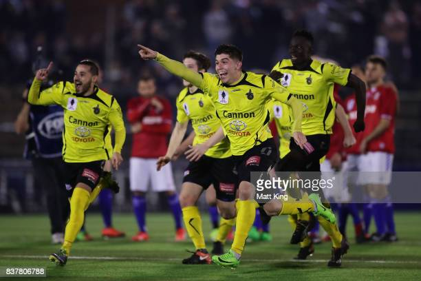 Alexander Schiavo of Heidleberg United and team mates celebrate victory after the penalty shoot out during the FFA Cup round of 16 match between...