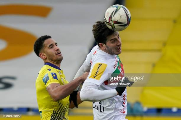 Alexander Schmidt of St.Poelten and Lukas Lochoshvili of Wolfsberg during the tipico Bundesliga match between spusu SKN St. Pölten and RZ Pellets WAC...
