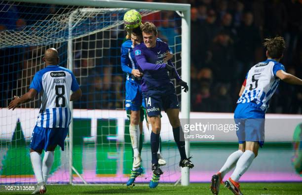 Alexander Scholz of FC Midtjylland and Jacob Lungi Sorensen of Esbjerg fB compete for the ball during the Danish Superliga match between Esbjerg fB...