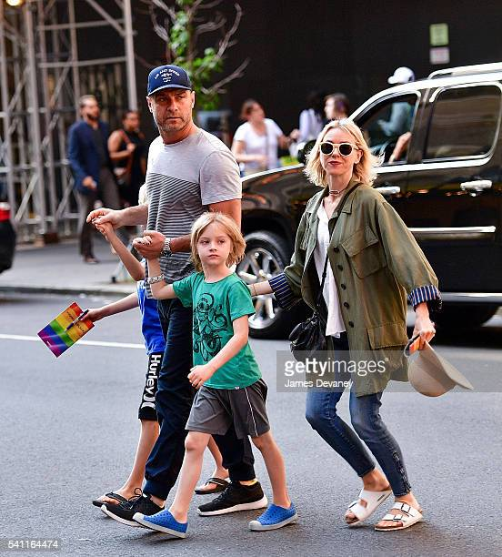 Alexander Schreiber Liev Schreiber Samuel Schreiber and Naomi Watts seen walking in Times Square after attending the Broadway musical Hamilton on...