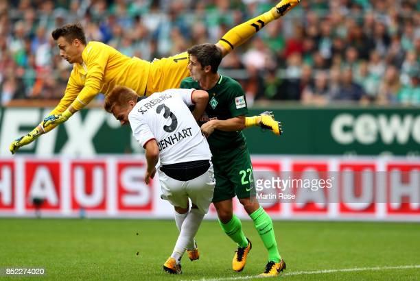 Alexander Schwolow goalkeeper of Freiburg crashes into team mate Philipp Lienhart and Fin Bartels of Bremen during the Bundesliga match between SV...