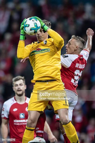 Alexander Schwolow of Freiburg makes a save against Pablo De Blasis of Mainz during the Bundesliga match between 1 FSV Mainz 05 and SportClub...