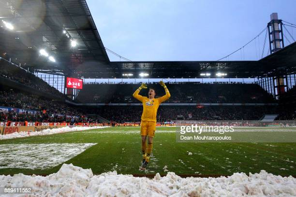 Alexander Schwolow of SC Freiburg celebrates his side's win following the Bundesliga match between 1 FC Koeln and SportClub Freiburg at...