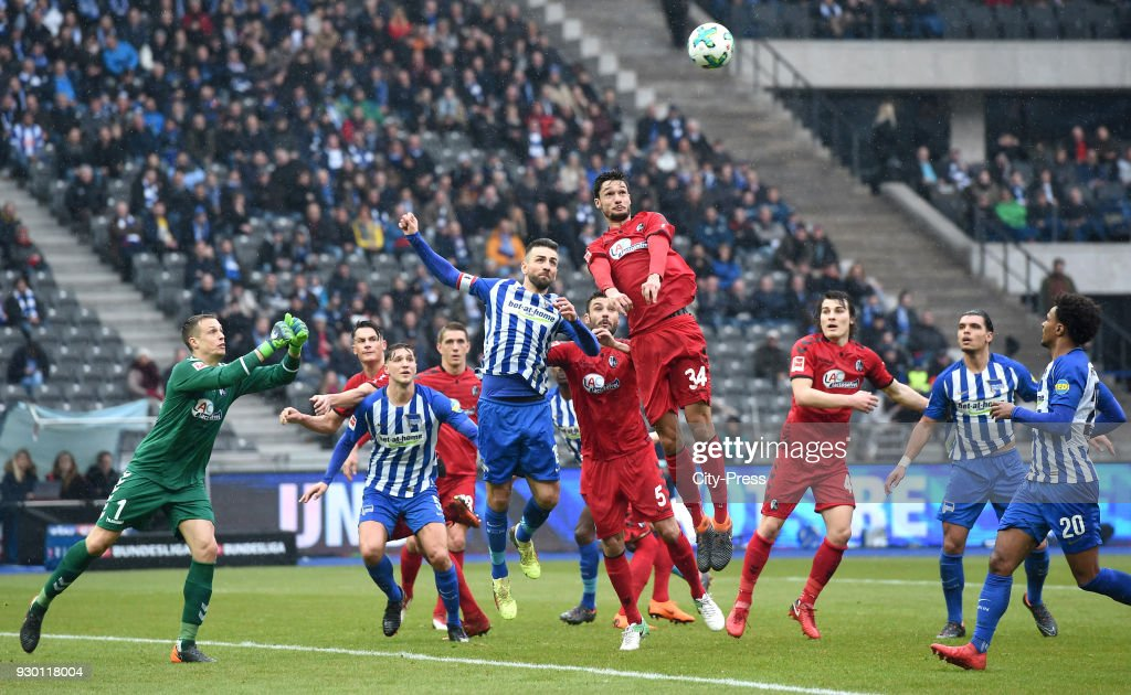 Alexander Schwolow, Robin Koch of SC Freiburg, Niklas Stark, Vedad Ibisevic of Hertha BSC, Manuel Gulde, Georg Niedermeier, Caglar Soeyuencue of SC Freiburg, Karim Rekik and Valentino Lazaro of Hertha BSC during the Bundesliga match between Hertha BSC and SC Freiburg at Olympiastadion on March 10, 2018 in Berlin, Germany.