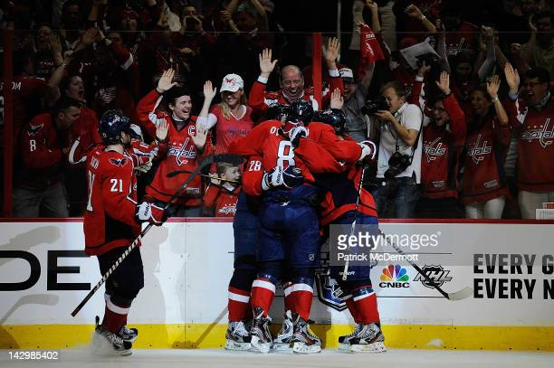Alexander Semin celebrates with Alex Ovechkin Brooks Laich and Nicklas Backstrom of the Washington Capitals after scoring a goal against the Boston...