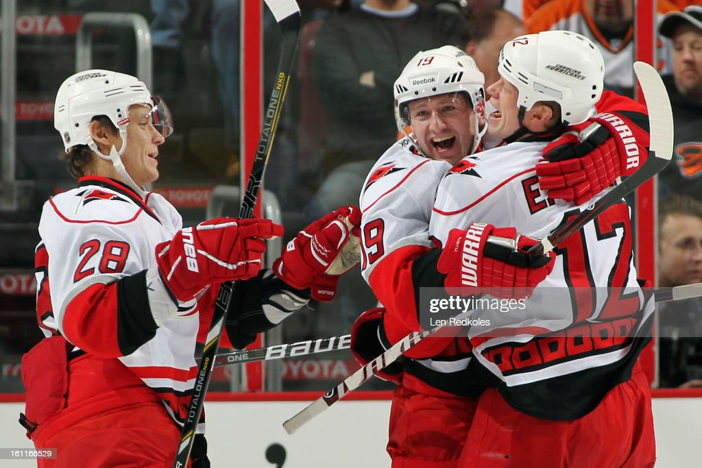 Alexander Semin #28, Jiri Tlusty #19, and Eric Staal #12 of the Carolina Hurricanes celebrate Tlusty's first period goal against the Philadelphia Flyers on February 9, 2013 at the Wells Fargo Center in Philadelphia, Pennsylvania. The goal was Tlusty's first this season.