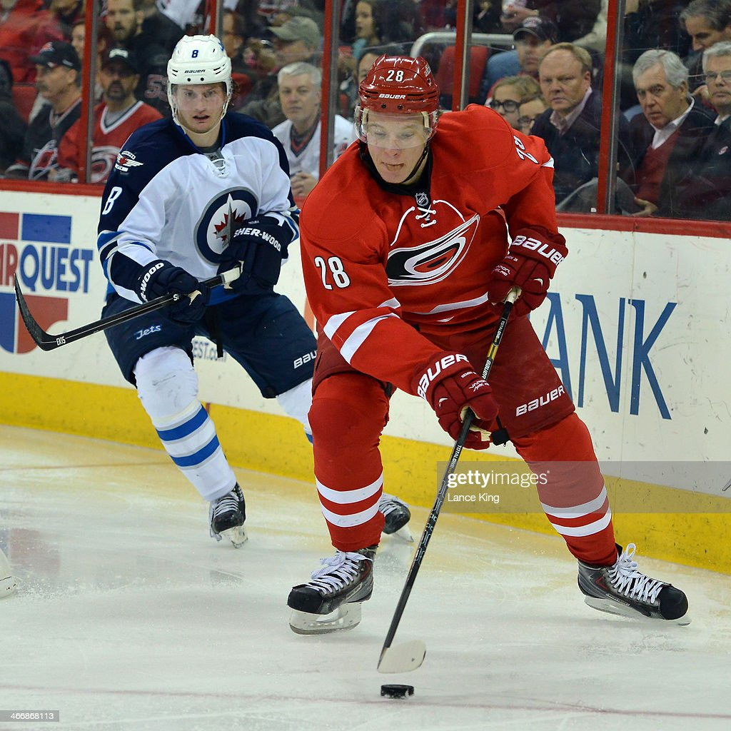 Alexander Semin #28 of the Carolina Hurricanes skates with the puck against Jacob Trouba #8 of the Winnipeg Jets at PNC Arena on February 4, 2013 in Raleigh, North Carolina. The Jets defeated the Hurricanes 2-1.