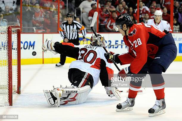 Alexander Semin of the Washington Capitals shoots and scores against Brian Elliott of the Ottawa Senators at the Verizon Center on March 30 2010 in...