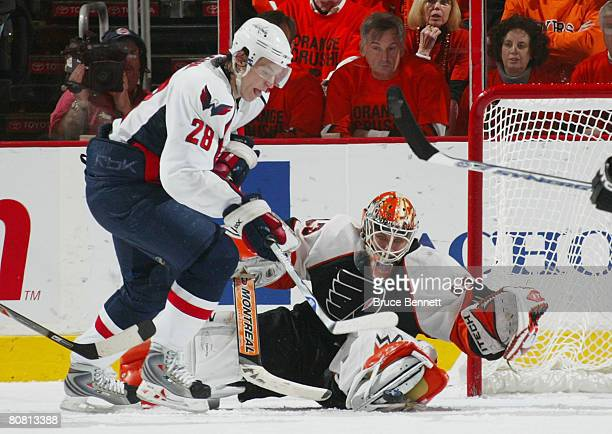 Alexander Semin of the Washington Capitals ties the score at 22 at 1803 of the second period against Martin Biron of the Philadelphia Flyers in game...