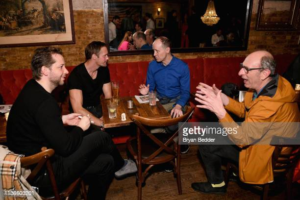 Alexander Skarsgar Grant Shaffer and David Cale attend a special performance of Legal Immigrant starring Alan Cumming at Audible's Minetta Lane...