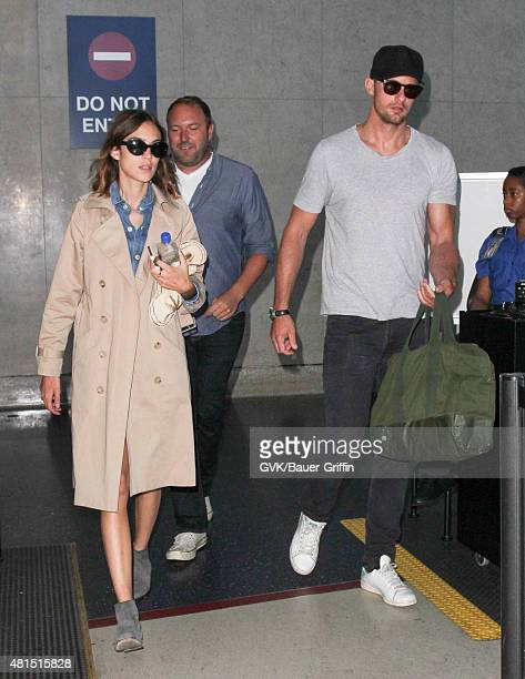 Alexander Skarsgard and Alexa Chung are seen at LAX on July 21 2015 in Los Angeles California