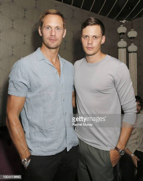 Alexander Skarsgard and Bill Skarsgard wearing Ermenegildo Zegna attend Flaunt and Ermenegildo Zegna's celebration of The Prelude Issue with Bill...